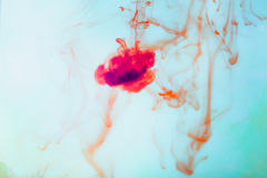 Red ink in water, artistic shot, abstract background Royalty Free Stock Image