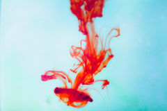 Red ink in water, artistic shot, abstract background Stock Photography