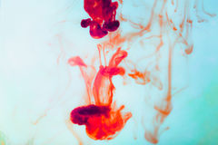 Red ink in water, artistic shot, abstract background Stock Images