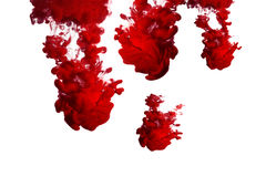 Red Ink in Water. Ink in water isolated on white background royalty free stock photography