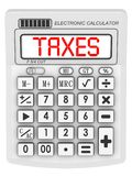 Taxes. Inscription on the electronic calculator Royalty Free Stock Images