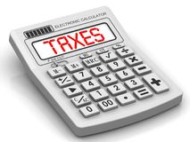 Taxes. Inscription on the electronic calculator Royalty Free Stock Photos