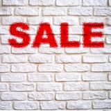 Red inscription on white brick wall. Red inscription sale on a white brick wall with space for your inscriptions Royalty Free Stock Photos