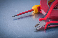 Red insulating tape nippers insulated screwdriver construction c Royalty Free Stock Images