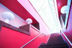 Red interior stair. And people moving Royalty Free Stock Images