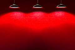 Red interior stone wall with lamps Royalty Free Stock Image