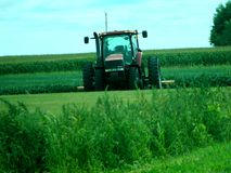 Red International Harvester tractor in a Iowa farm field Royalty Free Stock Photography