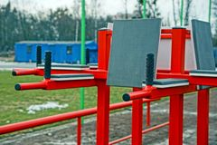 Red iron bars in the sports field Royalty Free Stock Photography