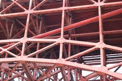 Red Iron beams under the Golden Gate Bridge Royalty Free Stock Image