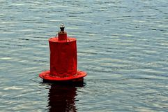Red iron buoy in the water of the river Royalty Free Stock Photos