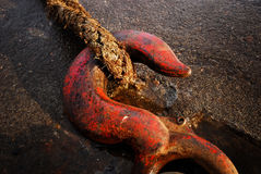 Red iron hook holding rope Royalty Free Stock Photography
