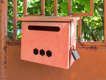 Red iron mailbox on homepage Royalty Free Stock Image