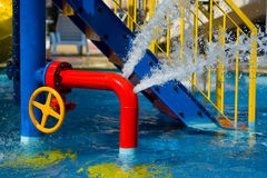Red iron tube in pool Royalty Free Stock Photo
