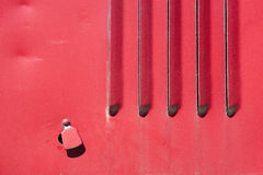 Red iron wall with a hole Royalty Free Stock Image