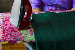 Red irons, ironing irons, housewives make fabrics smoother Stock Photo