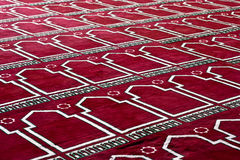 Red Islamic praying Carpet In pattern. Red Islamic praying Carpet or a rug In pattern, at a mosque Royalty Free Stock Photo