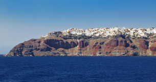 Red island of Santorini from long distance, Greece Royalty Free Stock Image