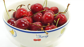 Red isolated cherries. In plate on white background Stock Image