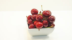 Red isolated cherries. In plate on white background Royalty Free Stock Images