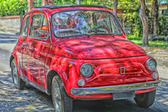 Red Italian runabout. Red vintage Italian runabout car in green park Stock Images