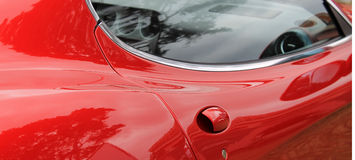 Red italian sports car door handle Royalty Free Stock Photo