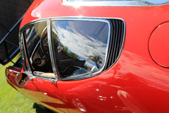 Red italian sports car rear window and vent. 1960s classic red italian sports car rear window and vent Stock Image