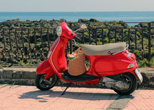 Red Italian Vespa. Parked on the boardwalk in sicily,Italy Royalty Free Stock Images