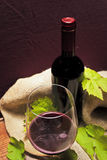 Red italian wine. A glass of brunello (italian typical wine) and the bottle Royalty Free Stock Photography