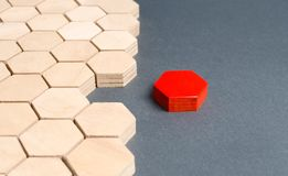 Red item is disconnected from other items. Hexagons. The concept of separating parts from a whole or connecting parts to a whole. Business process, logical royalty free stock photo