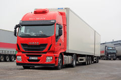 Red Iveco and other Cargo Trucks on Warehouse Yard Royalty Free Stock Photography
