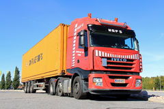 Red Iveco Truck and Trailer. FORSSA, FINLAND - SEPTEMBER 7: Iveco truck and trailer on September 7 in Forssa, Finland. The Iveco Stralis Hi-Way has been elected stock photos