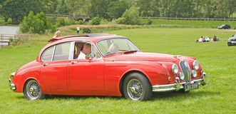 Red Jaguar arriving at the Rally. Royalty Free Stock Photo