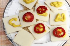 Red Jalapenos, Cheddar Cheese, Mustard on Crackers. Snack of crackers with red jalapenos, cheese and mustard. Appetizer of cheese mustard pepper slices stock images