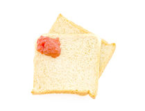 Red jam paint on the bread Royalty Free Stock Photo