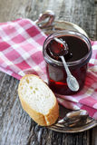 Red jam and slice of baguette Stock Photography