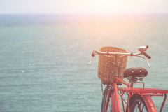 Red Japan style classic bicycle at ocean view point Stock Image