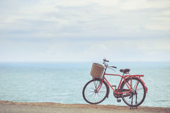 Red Japan style classic bicycle at ocean view point Royalty Free Stock Photo