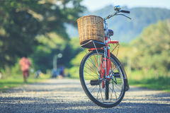 Red Japan style classic bicycle at the park Royalty Free Stock Images