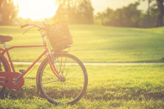Red Japan style classic bicycle at the park Royalty Free Stock Photography