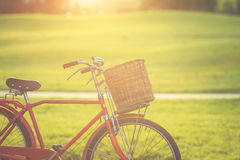 Red Japan style classic bicycle at the park Royalty Free Stock Photos