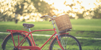 Red Japan style classic bicycle at the park Stock Photos
