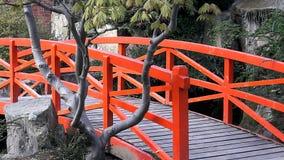 Red Japanese Bridge. In Japanese style garden Stock Photography