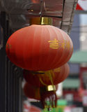 Red Japanese Lanterns. Hanging from Building Stock Photos