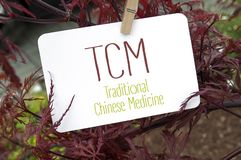 Red japanese maple with card board and TCM royalty free stock photo
