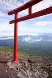 Red Japanese tori gate on top of Mt. Fuji Stock Photography
