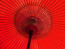 Red japanese umbrella. A traditional japanese red umbrella against the sun Royalty Free Stock Photo