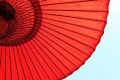 Red Japanese Umbrella. Closeup of design underneath the red Japanese umbrella Royalty Free Stock Photo