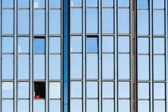Red jar in a open window of a office building Royalty Free Stock Photos