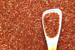 Red Jasmine Rice And Ladle Stock Photo