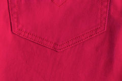 Red jeans background. Red jeans texture with pocket Stock Photography